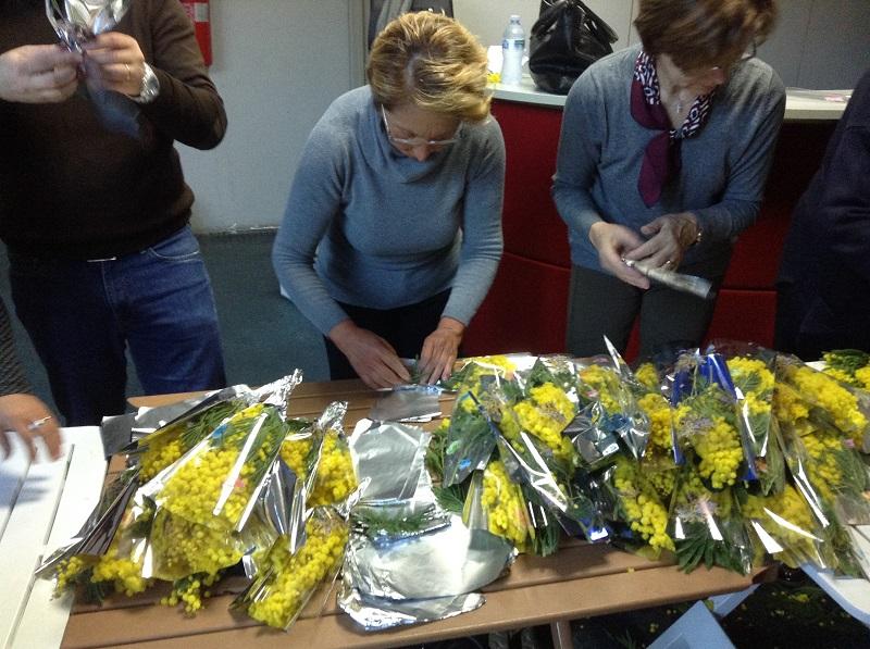 confezionamento mimose Cgil Cisl Uil per 8 marzo